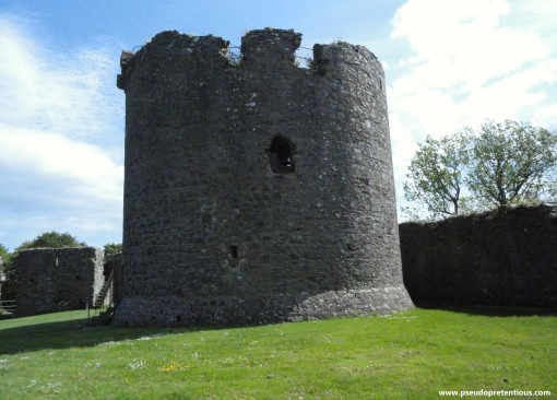 Dundrum Castle keep with part of the gatehouse visible in the background, to the left.