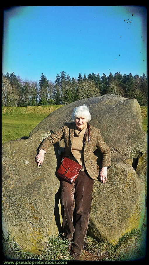 mum-in-law leaning against the passage tomb at the giant's ring